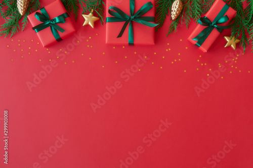 Fototapeta Christmas flat lay background with fir tree, present box and decorations. Free space for design. obraz