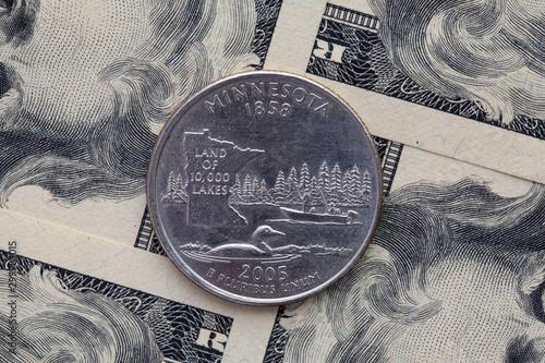Fototapeta Symmetric composition of US dollar bills and a quarter of Minnesota. obraz