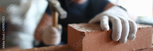 Professional bricklayer working on construction