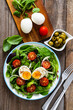 Salad with boiled egg and vegetables