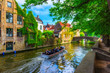 Leinwanddruck Bild View of the historic city center of Bruges (Brugge), West Flanders province, Belgium. Cityscape of Bruges with canal.