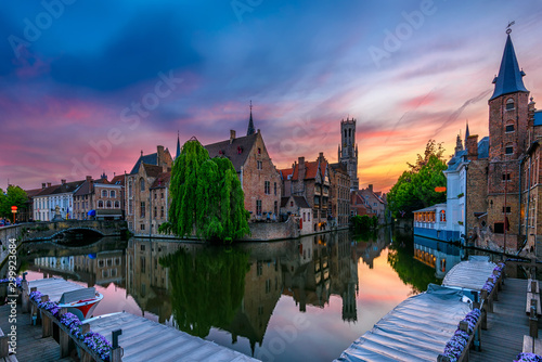 Wall Murals Bridges Classic view of the historic city center of Bruges (Brugge), West Flanders province, Belgium. Night cityscape of Bruges.