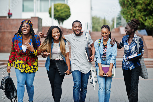 Stampa su Tela Group of five african college students spending time together on campus at university yard