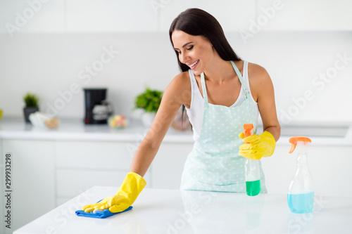 Obraz na plátně  Portrait of positive cheerful girl wear yellow rubber latex wash polish desk usi