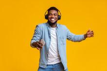 Cheerful Guy In Headphones Lis...