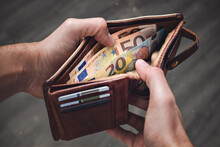 A Leather Wallet With Euro Banknotes Inside