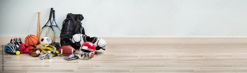 Fototapety, obrazy: Different Type Of Sports Equipment On Wooden Desk