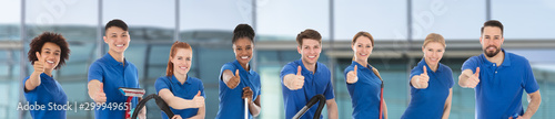 Smiling Multiracial Janitors Gesturing Thumbs Up Fototapete