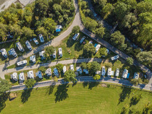 Aerial View Of Campground In Rural Area In Europe With Many Caravans. Concept Of Adventure And Outdoor Tourism In Europe.