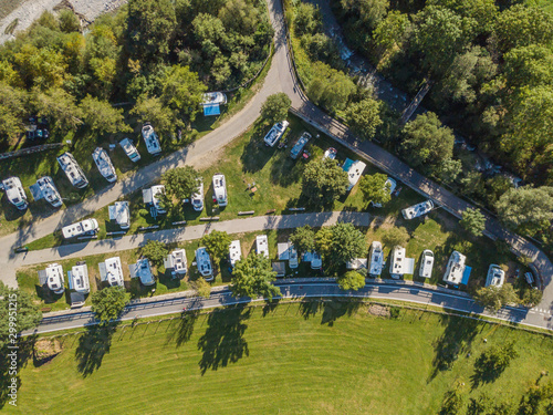 Fényképezés Aerial view of campground in rural area in Europe with many caravans