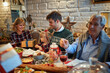 family enjoy on Christmas dinner and exchange gifts together