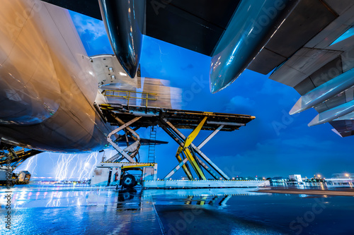 Cargo aircraft loading in thunderstorm Canvas Print