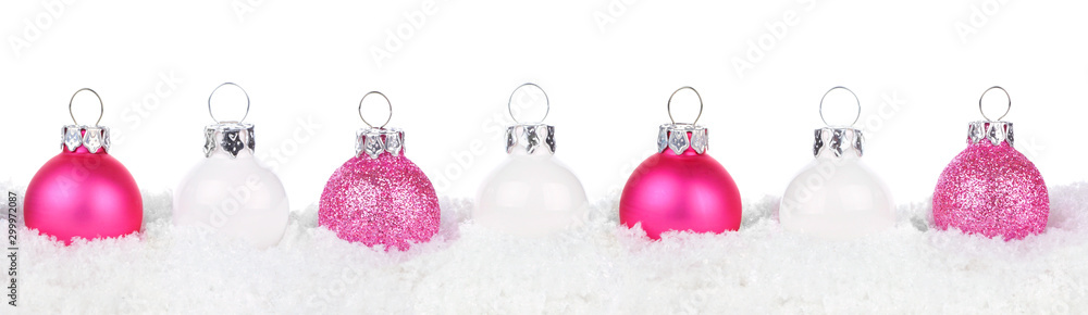 Fototapeta Christmas border of shiny pink and white baubles resting in snow isolated a white background