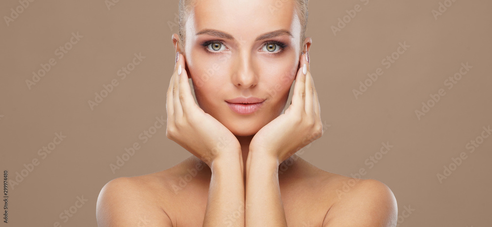 Fototapeta Beautiful face of young and healthy woman. Skin care, cosmetics, makeup, complexion and face lifting.