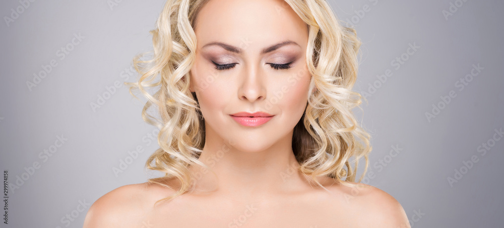Fototapety, obrazy: Beauty portrait of attractive blond woman with curly hair and a beautiful hairstyle. Makeup and cosmetics, face lifting and beauty concept.