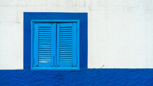 Mediterranean White Washed House With Blue Wooden Window Shutters
