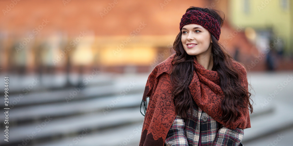 Fototapety, obrazy: Beautiful joyful woman portrait in a city. Smiling  girl wearing warm clothes and hat  in winter or autumn. Christmas time with  unfocus lights on backgrounde. Copy space