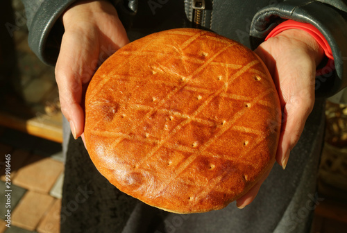 Fresh Baked Armenian Sweet Bread Called Gata in Woman's Hands