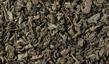 Dry Green Tea Leaves Backgroun...