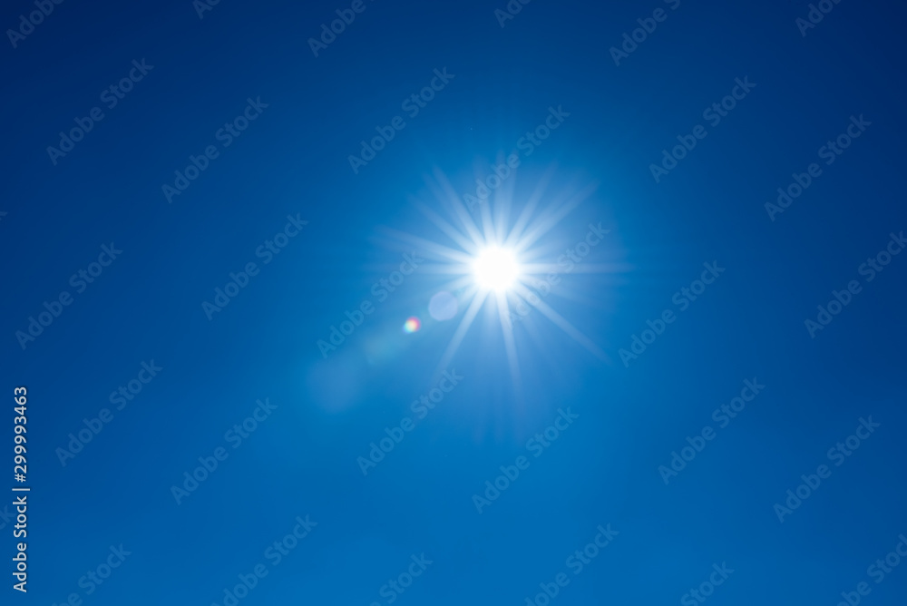 Fototapety, obrazy: Sun, sunbeams against blue sky - cloudless heaven. Photography with Lense flair effect