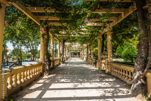 Stone balustrade with pergola and columns in Aveiro city park, Portugal Fototapeta