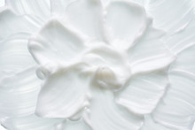White Texture And Smear Of Face Cream Or White Acrylic Paint Isolated On White Background