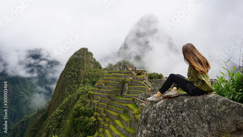 Woman Sitting On A Rock At Machu Picchu Canvas Print