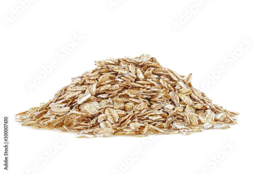 Obraz na plátne  Pile of oat flakes isolated on a white background