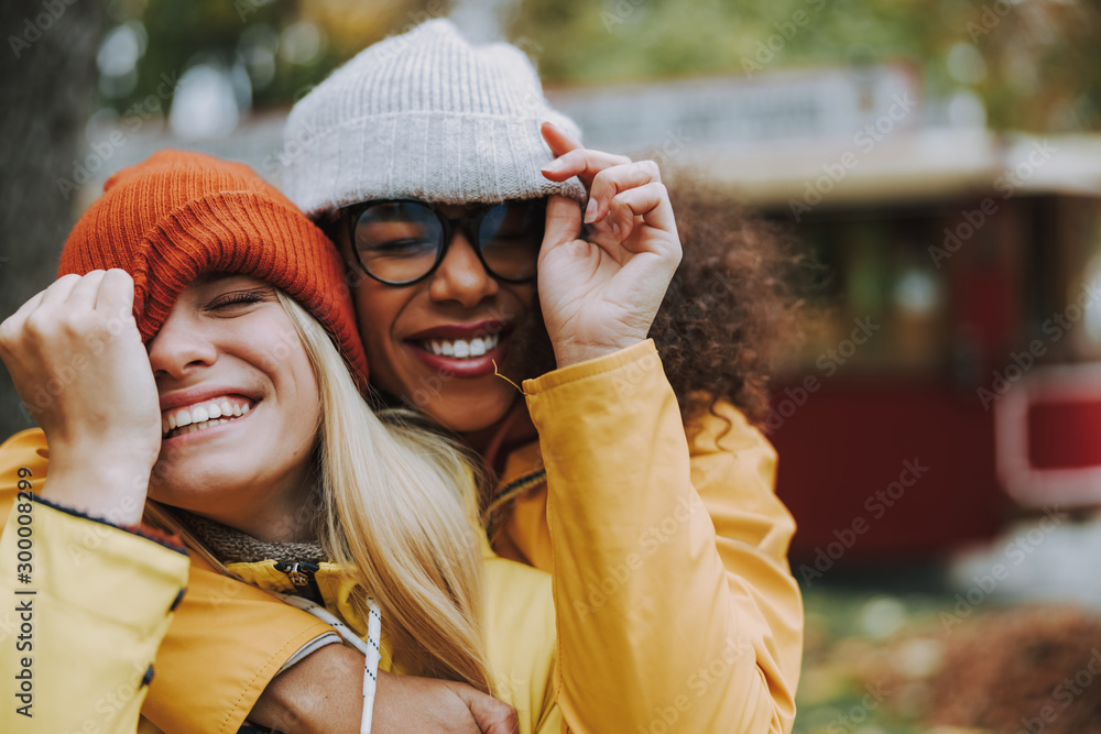 Fototapeta Two young women cuddling to each other