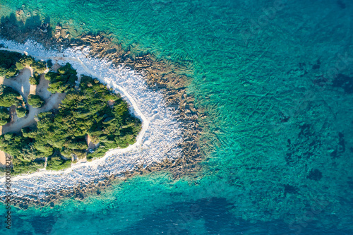 Aerial view of sea and beach in a lagoon on Cres ( isola Cherso ) Island Croatia, close to Punta Kriza ( Punta Croce ). It is a part of national where rocks and sand and forest merge on a coast.