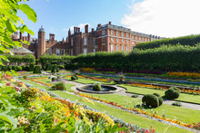 Georgian And Tudor Facades Of Hampton Court Palace With The Foreground Showing The Colorful Sunken Gardens