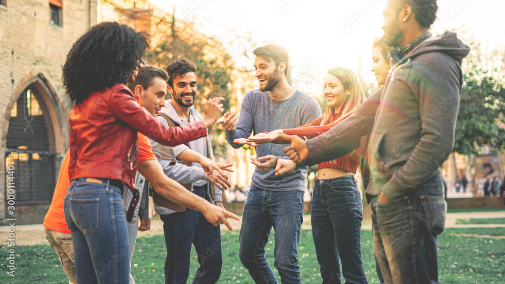 Fototapety, obrazy: Group of multiracial people playing at Rock Paper Scissors game. Students from different culture having fun outdoors