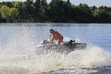Man Riding Jet Ski On The Water