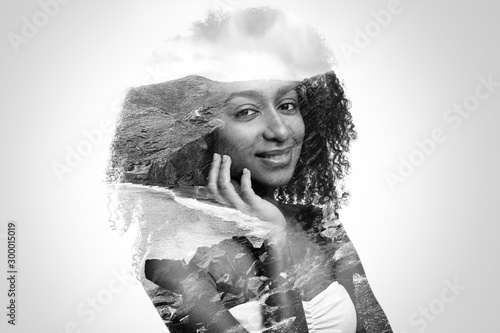 Double exposure of young African-American woman and seashore