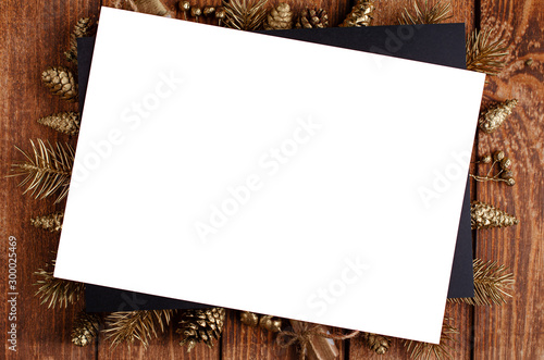 Photographie  Christmas and New Year festive golden ornament on wooden background