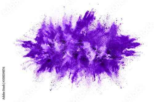 Powder explosion. Closeup of a purple dust particle explosion isolated on white. Abstract background. - 300034876