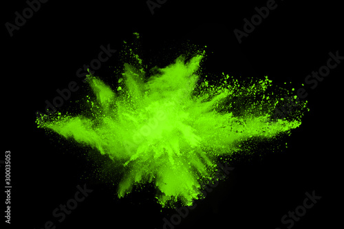 The movement of abstract dust explosion frozen green on black background. Stop the movement of powdered green on black background. Explosive powder green on black background. - 300035053