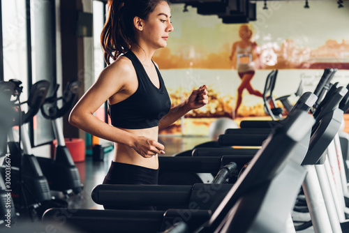 Poster Fitness Beautiful woman active running exercise workout on treadmill