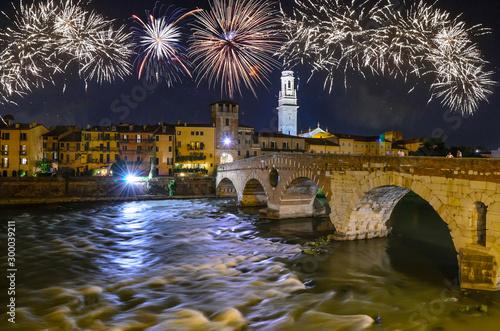 Ponte Pietra bridge on Adige river with fireworks at night in Verona, Veneto region, Italy Canvas Print
