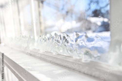 Ice forming on the inside glass of a drafty window in winter Wallpaper Mural