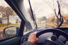 Hand On Steering Wheel On A Rainy Autumn Afternoon