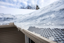 Ice Dam In Gutter And Ice Froz...