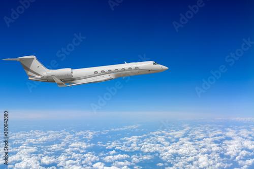 Obraz White airplane flying above cloud - fototapety do salonu