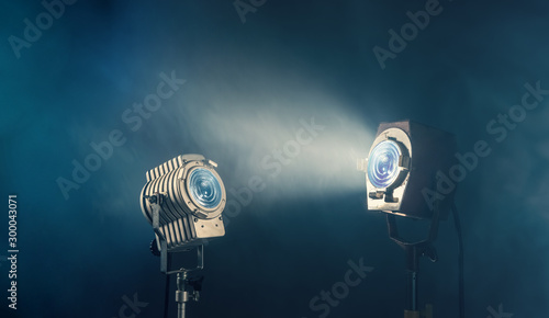 Vászonkép Vintage studio spot lights with smoke