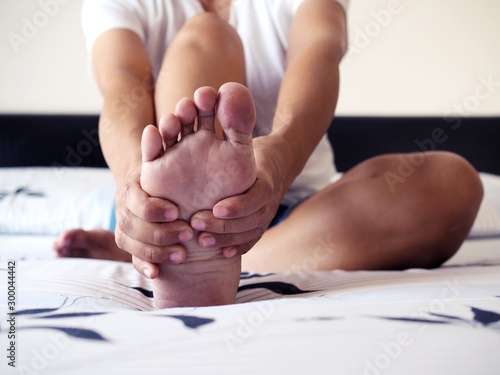 Female feet and soles of the heel with heel pain in adults and Treatment of Plantar Fasciitis Fototapeta