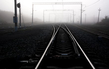 Railway Tracks In Fog