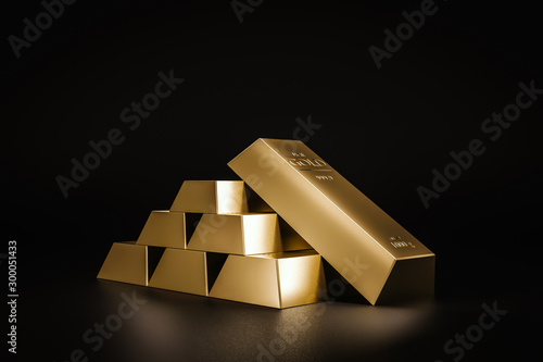 Stack of gold bars on dark background of wealth from trading profits of fast growing businesses Canvas Print