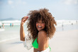 Black afro young cute girl, curly hair, bikini, beach. Afro American summer vacation holiday.