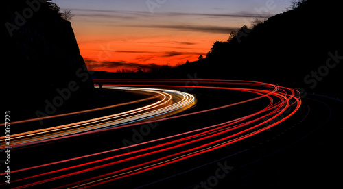 tail light streaks on highway at night. Long exposure. Wallpaper Mural