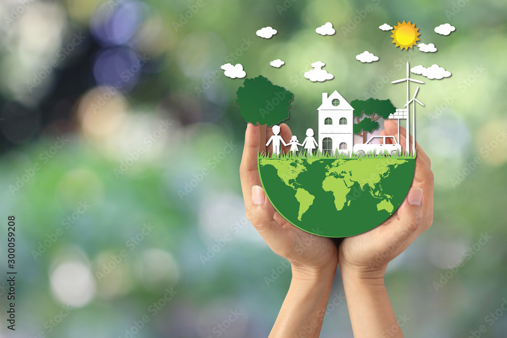 Fototapety, obrazy: Man hand holding green world with model house and model family on natural green background, We love the world of ideas